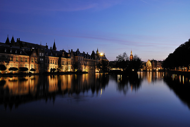 Reflections of Binnenhof and Grote Kerk in the Hofvijver pond